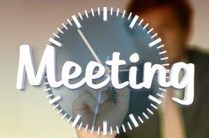 Imagen de reloj y la palabra meeting